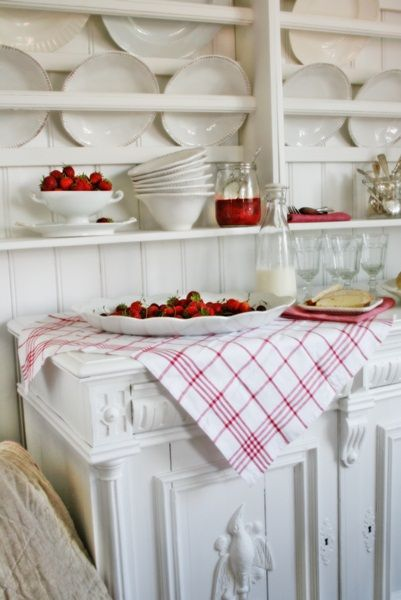 A white kitchen adds red