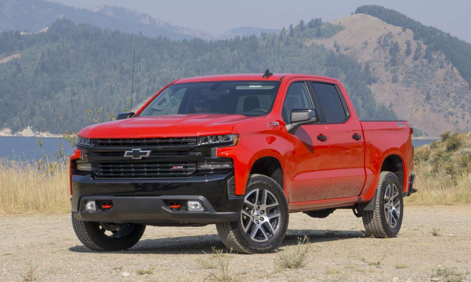 2019 Chevy Silverado A Red And Black Truck Parked In Front Of A