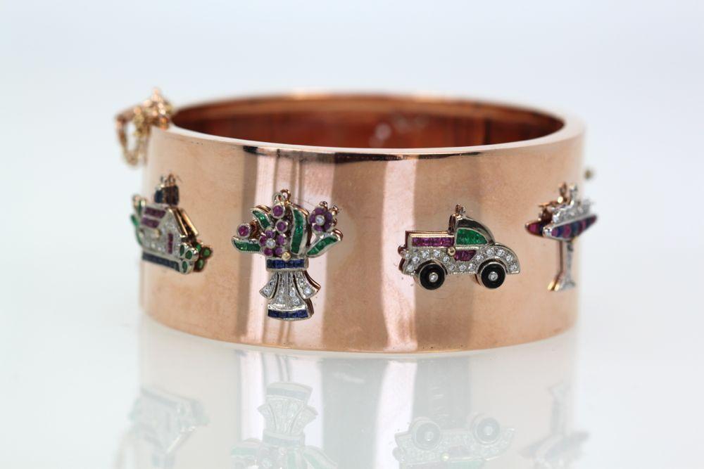 Art Deco Platinum, gold and gems charm bracelet
