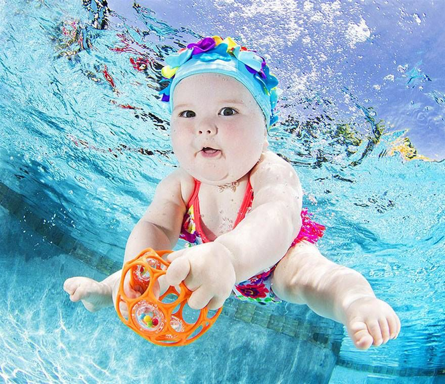 Baby swimming w/ Oball rattle