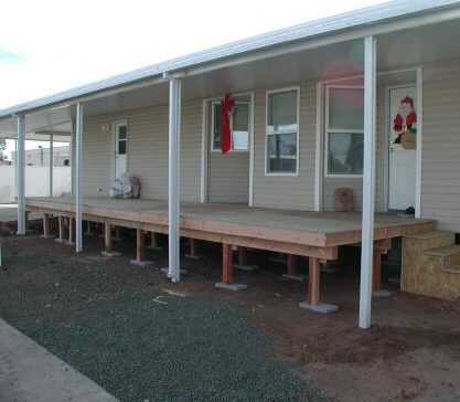 Mobile Home Building On Patio on decks on mobile homes, sunrooms on mobile homes, roofing on mobile homes, gutters on mobile homes, garage doors on mobile homes, fences on mobile homes, porch on mobile homes,