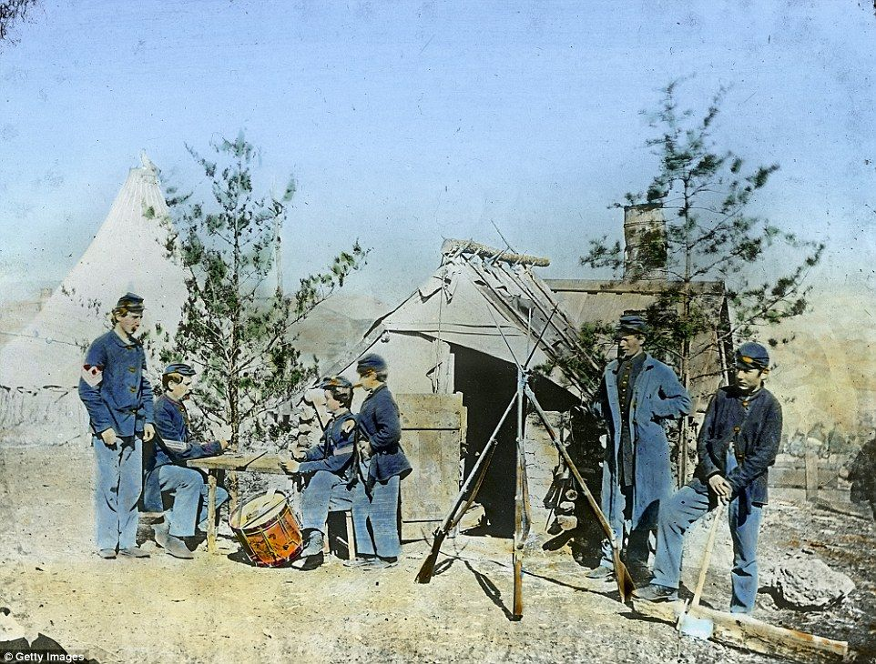 A Union drummer boy and sergeants in 1862. Drummer boys, who were often very young, played an important role in the Civil War - as officers' orders were given as a series of drumbeats during battle so they could be heard above the noise and confusion