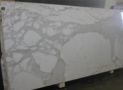White marble with bluish veining- would be nice to use on vanity counter and on tub surround.