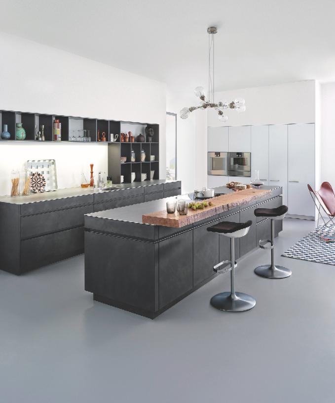Nothing Captures The Industrial Trend Quite Like A Concrete Island This Sleek Design Is By German Kitchen Manufacturer Kuchendesign Kuche Beton Moderne Kuche