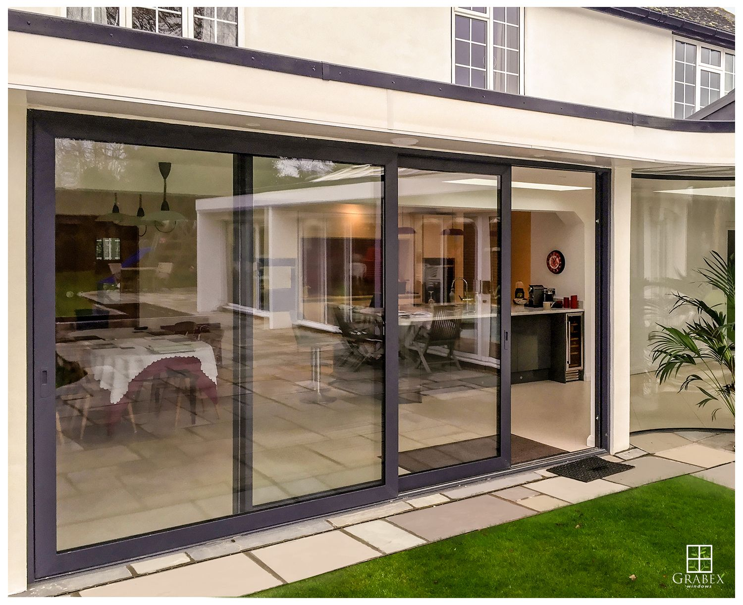 Aluminium Sliding Doors And Curved Glass Surrey House
