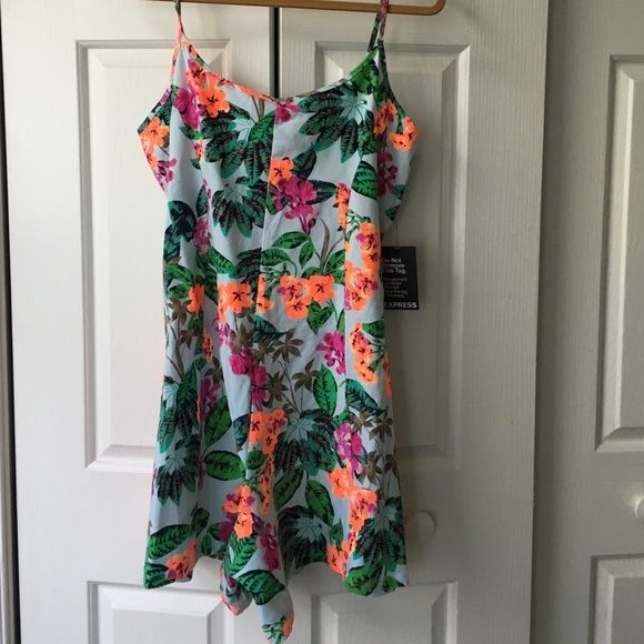 e48780a2d0cf NEW Express Romper Tropical and floral brand new Express shortie romper!  How cute is this for summer   Adjustable straps. 95% cotton. 5% spandex.