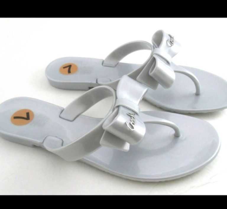 4e3c7c2d1 Check out Coach silver bow sandal flip flops on Threadflip!