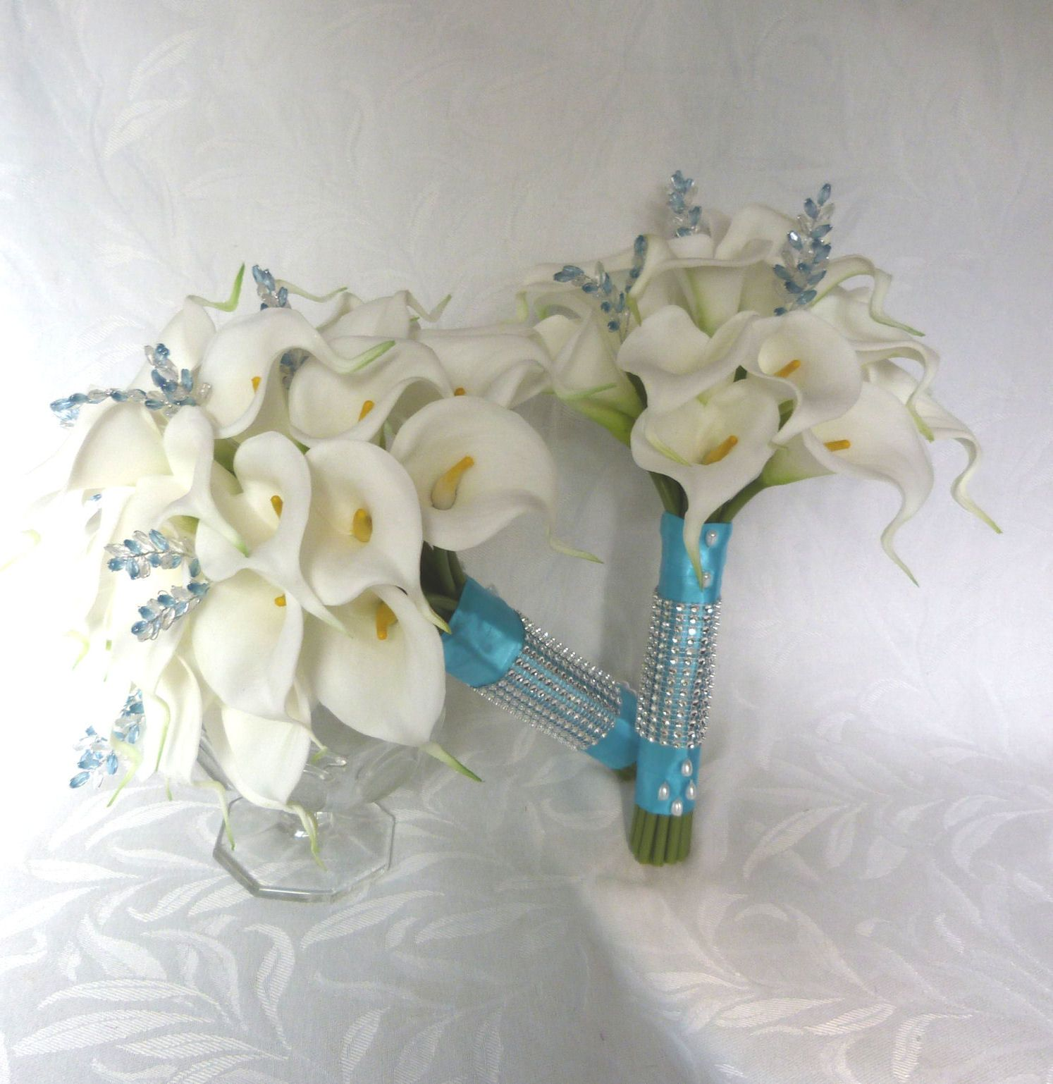 This beautiful hand tied bridal bouquet contains 30 real touch mini white mini real touch calla lily bridal bouquet set o simple modern elegance this beautiful hand tied bridal bouquet contains 30 real touch mini white izmirmasajfo Choice Image