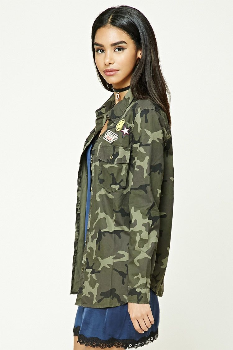 A Cotton Camo Print Shirt Featuring Various Patches Including I