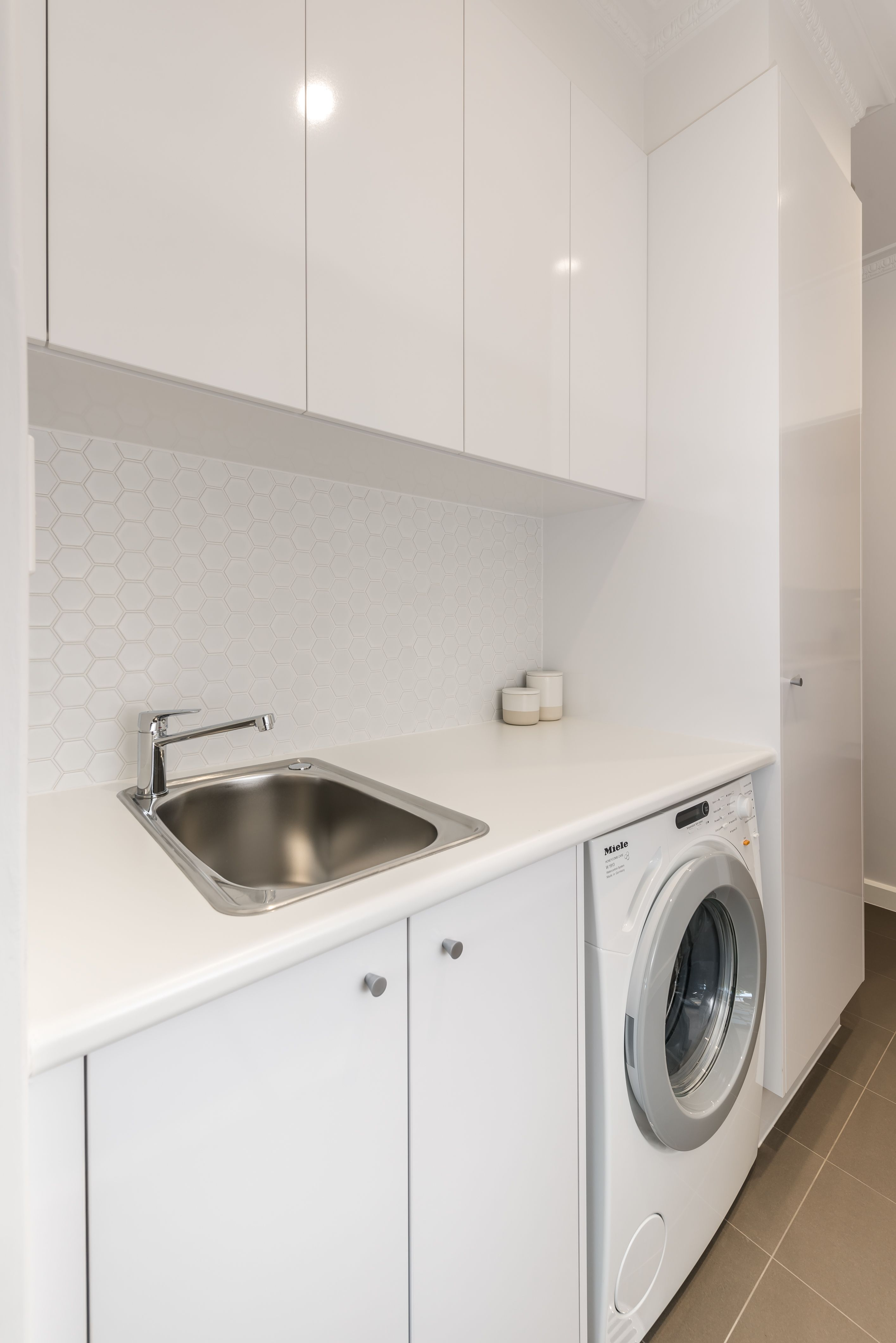Small Laundry Renovations Small Compact Laundry With Plenty Of Benchspace Brilliantsa