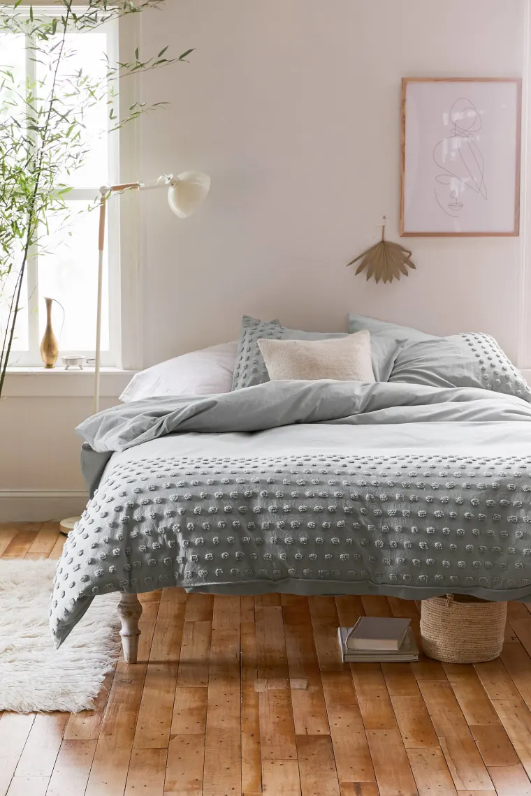 Photo of Brighten Up Your Space with Colorful Rugs and Bedding from Urban Outfitters' Home Sale