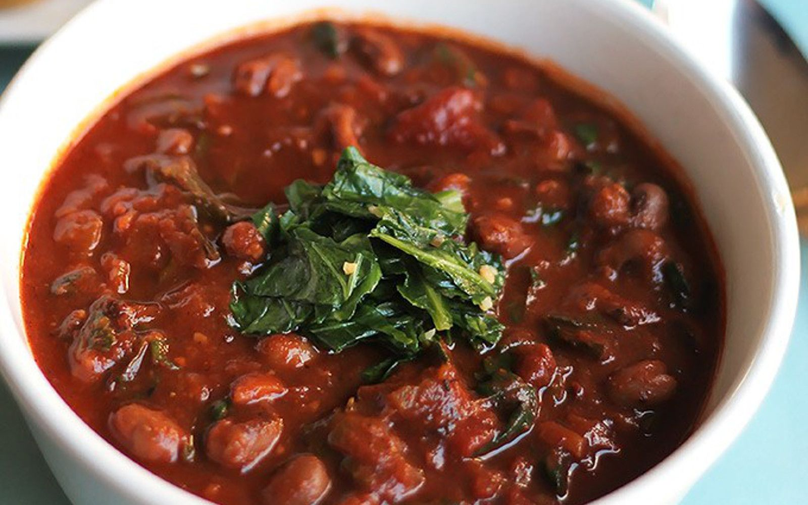 <p>This black-eyed pea chili is slowly simmered over six hours so that the flavors can fully blend together, and then served over sautéed collard greens. It's delicious, filling, and healthy.</p>