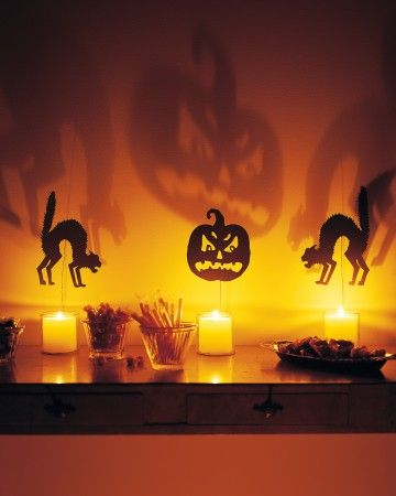As day turns to night, call on candles to cast an eerie glow throughout your home. When fierce silhouettes are propped above them, spectacular shadows dance across the walls.