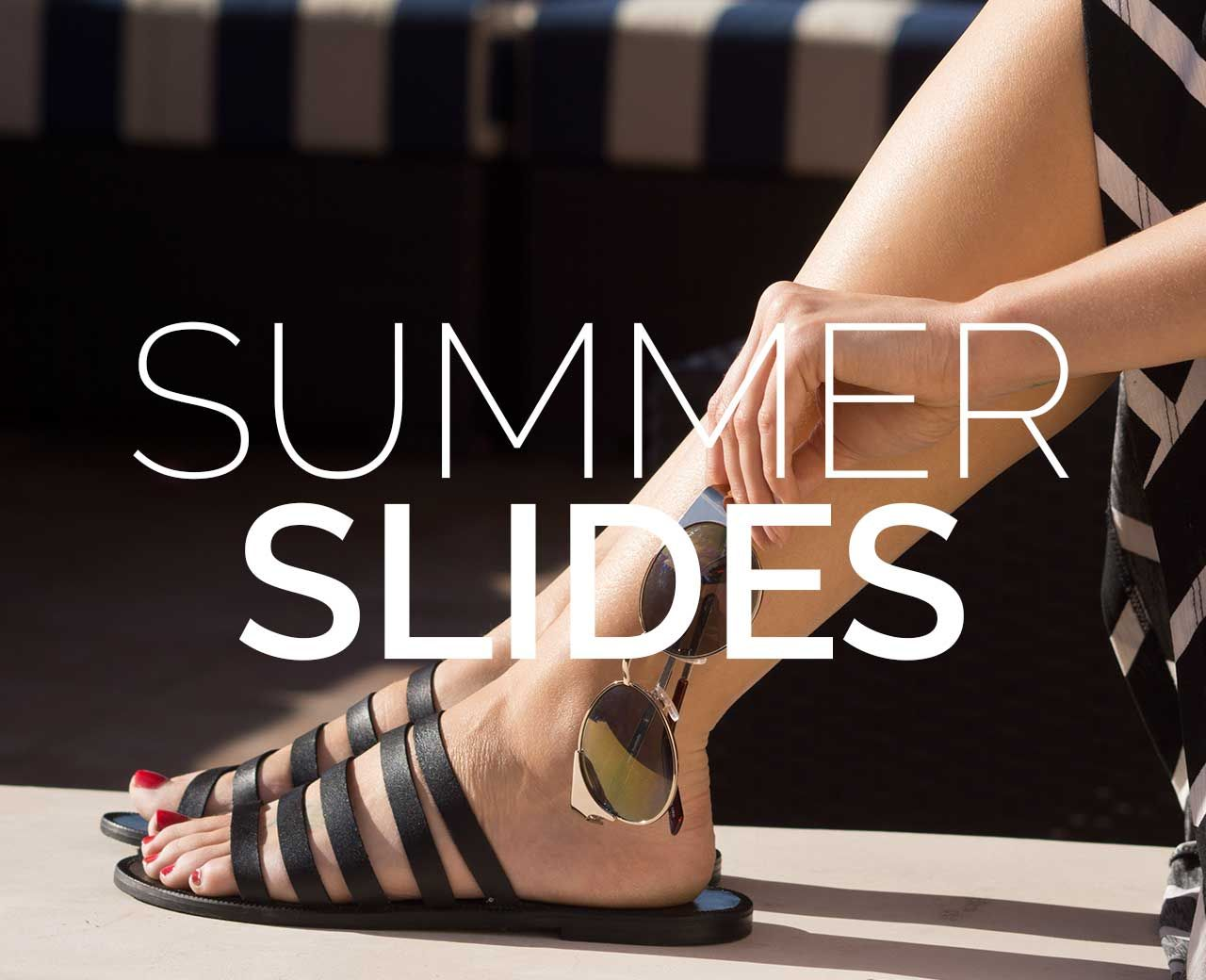 Slide Into Summer With These Hot Black Strappy Slide Cage Sandals