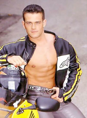Shirtless Male On Motorcycle Wearing Black Leather