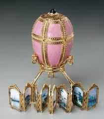 Fabergé: Imperial 'Danish Palaces' Egg 1890. The exterior of this egg is pink-mauve enameled gold split into 12 sections. 6 vertical lines of rose-cut diamonds & 3 horizontal lines separate the panels. There is an emerald at each intersection of the lines