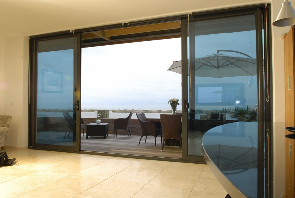 Sliding glass patio doors sliding patio doors provide a for Backyard sliding door
