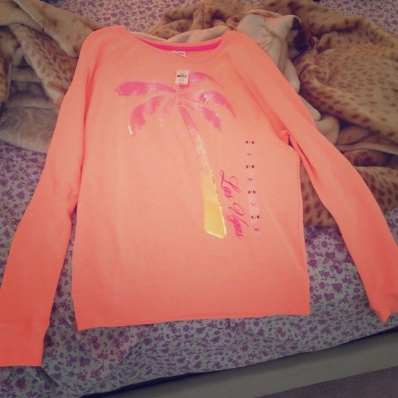 SOLD OUT VS Pink sweatshirt 2016 spring collec BRAND NEW WITH TAGS ATTACHED. Just paid 80+ dollars for this.. (Don't remind me) SIZE MEDIUM. But fits a Large AS well Never worn. Such a hot PEACHY color!! Pics don't do justice! Xo NEGOTIABLE! CANT BE FOUND ANYWHERE SOLD OUT! PINK Victoria's Secret Tops Sweatshirts & Hoodies