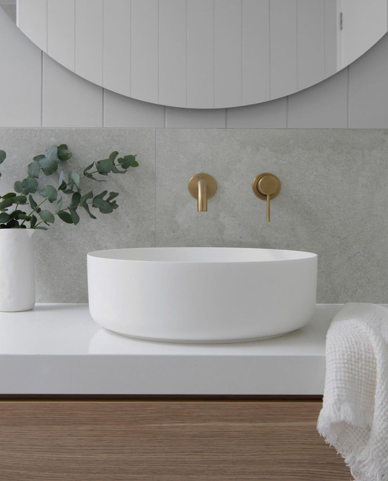 Photo of Coastal Bathroom Design | White bench top with round counter top Basin and Brass taps