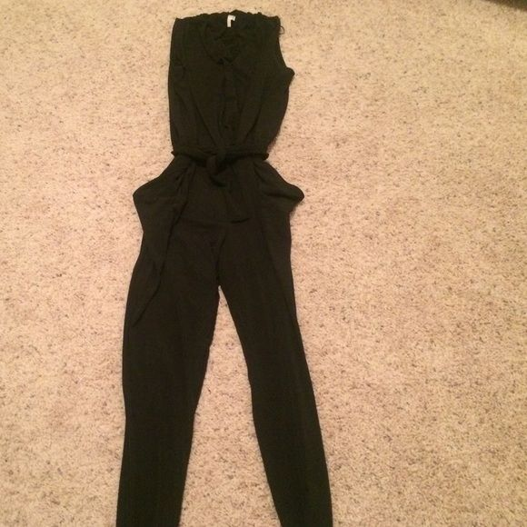 Michael by Michael Kors jumpsuit This jumpsuit is made out of a jersey know material in a size small in black. It has a tie across the waist and deep pockets. It is very comfortable and perfect for any occasion! MICHAEL Michael Kors Pants Jumpsuits & Rompers