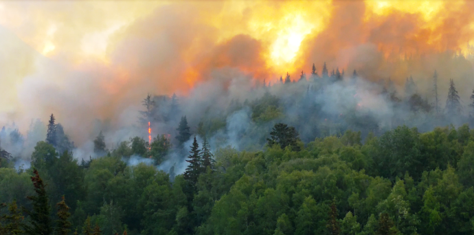 No evacuations, road open as crews battle wildfire south of Anchorage