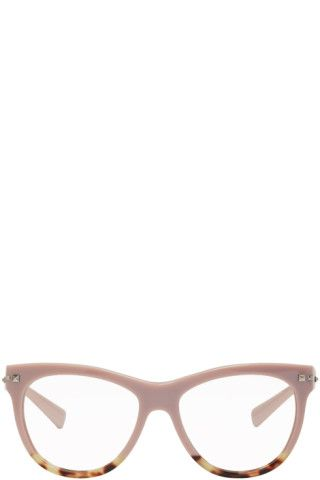 b4975b11dc0 Round acetate optical glasses colorblocked in pink and tortoiseshell.  Signature pyramid stud at hinges and temple tips. Silver-tone logo stamp at  temple ...