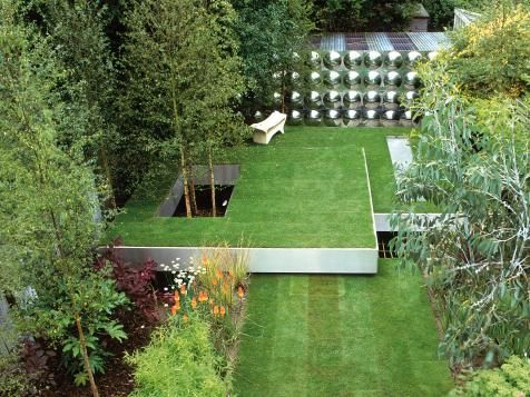 Here we see stunningly symmetrical landscape design principles applied using sharp right angles, cylindrical shapes and multiple levels.