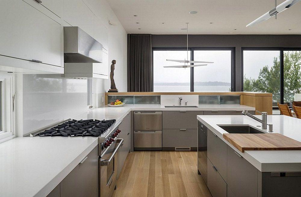 Modern Metal Kitchen Cabinets With White Caesarstone Countertop Island