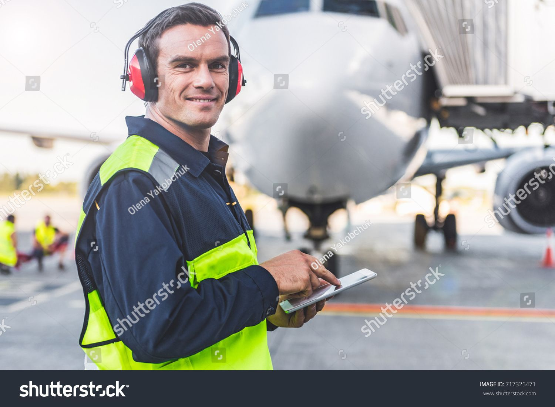 Happy mechanic having job in airdrome Sponsored ,