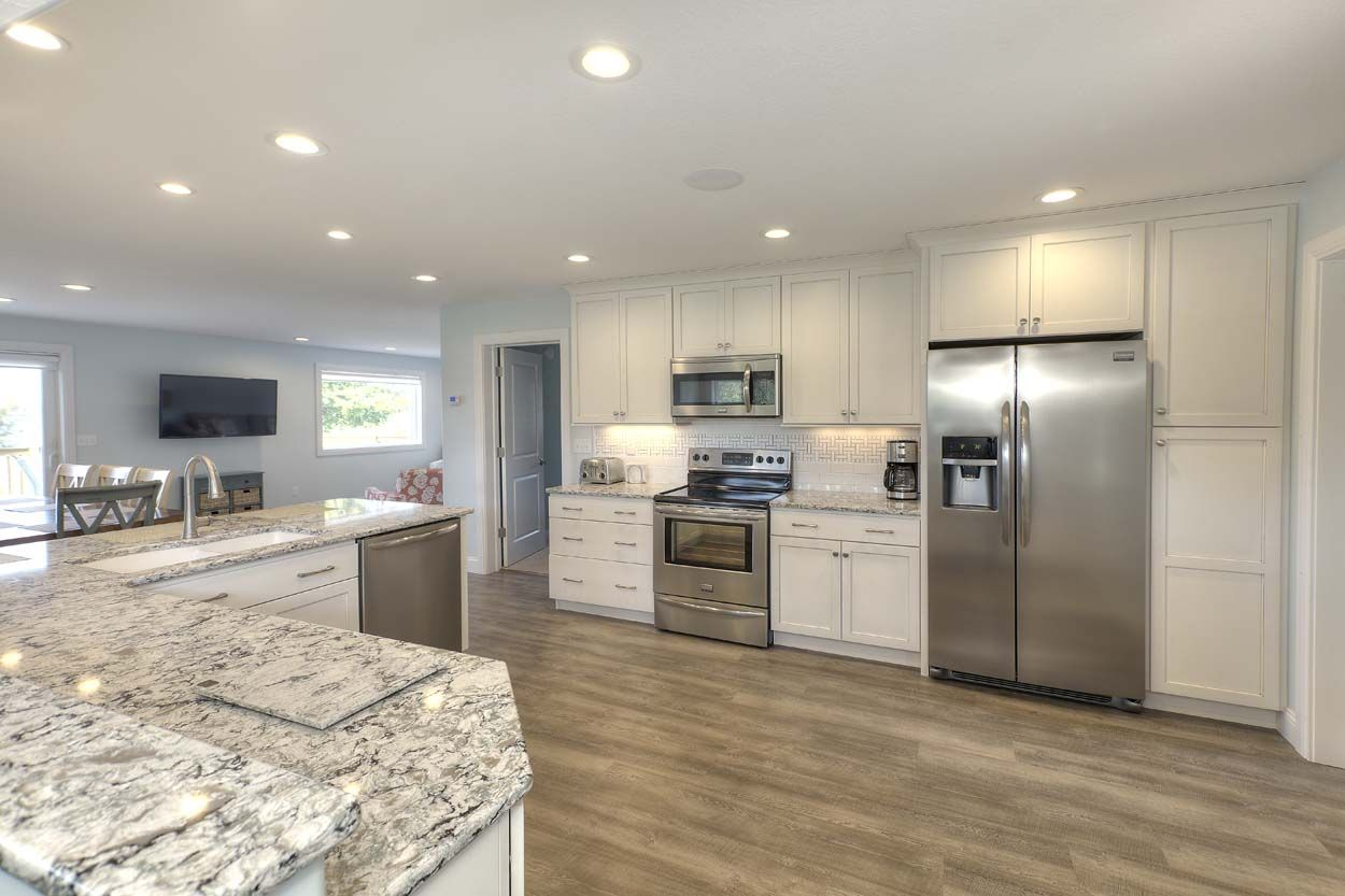 A Wide Open Kitchen In Traverse City Michigan Was Designed By Angela Goodall At Kitchen Choreography Kitchen Cabinets In Bathroom Off White Cabinets Kitchen