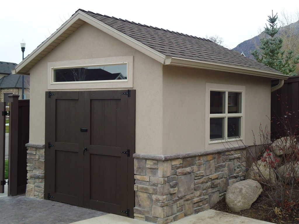 Stucco and rock orchard shed sheds garden bridges for Stucco garage