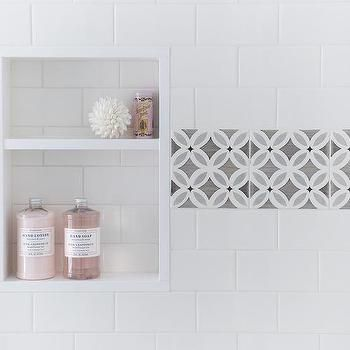 charming shower niche designs. Beautiful shower is clad in white subway tiles accented with gray border  framing a tiled niche filled pink bath accents White Shower Tiles Gray Border Framing Tiled