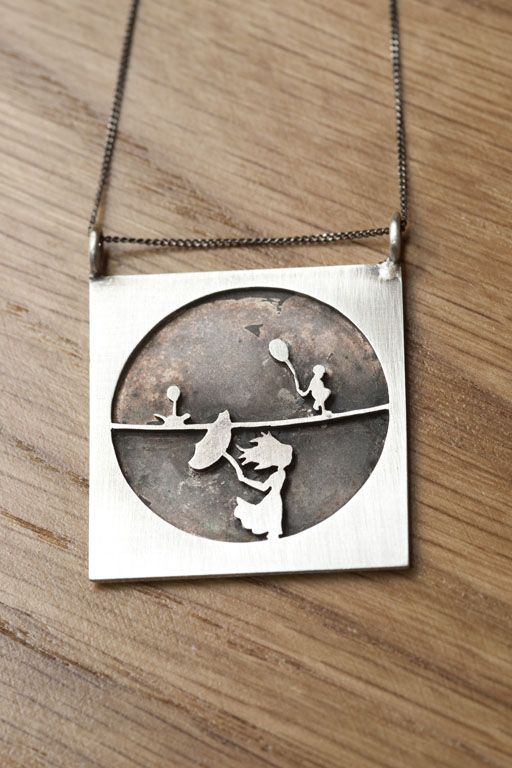 Girl with umbrella, boy and cat on the tight rope. sterling Silver. by Natasha Wood Jewellery