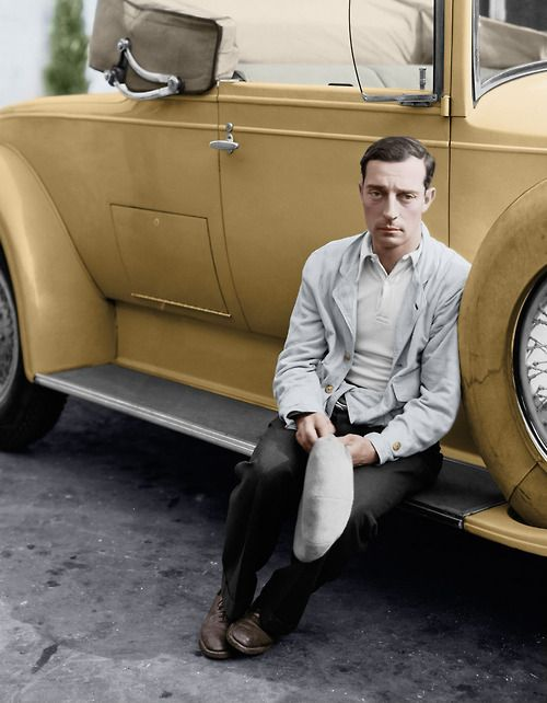 Colorized version of Buster Keaton and his convertible. 1930