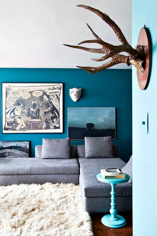 love that dark teal with a grey couch accent wall livingroom