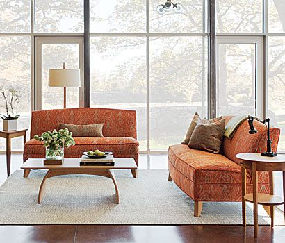 """living room - Calais loveseats upholstered in Anichini fabric """"Mozart"""" color orange/ neutral.  Belmont coffee table and Strafford end table are in cherry."""