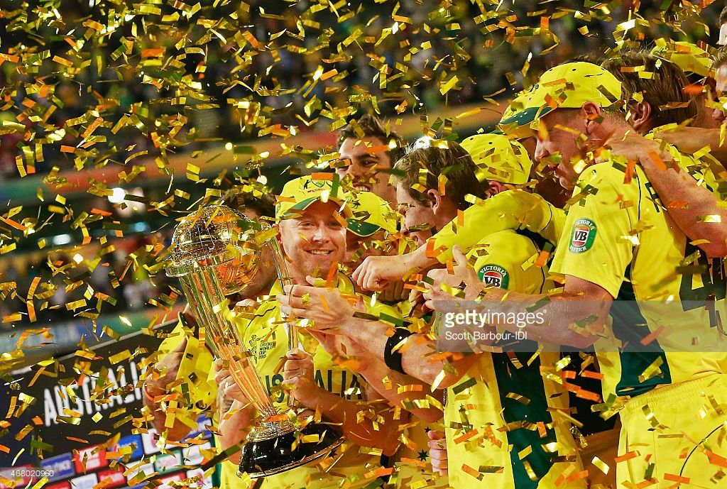 Australian captain Michael Clarke, Steven Smith and Australian players celebrate with the World Cup trophy as they celebrate after Australia won the 2015 ICC Cricket World Cup final match between Australia and New Zealand at the Melbourne Cricket Ground on March 29, 2015 in Melbourne, Australia.