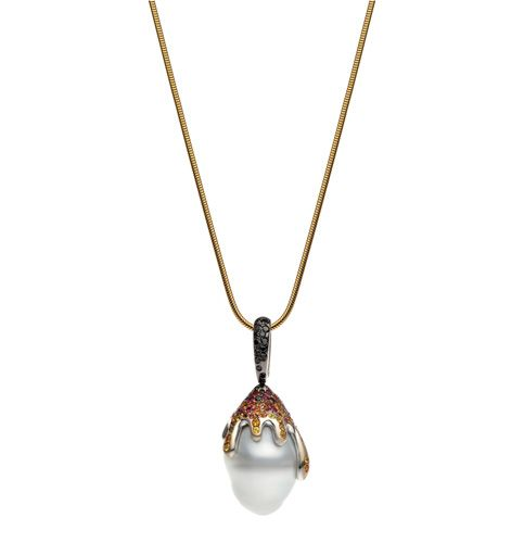 AUTORE Boutique pendant in white gold with South Sea pearl, rubies, orange and yellow sapphires, and brown and black diamonds. Pictured here with yellow gold chain.