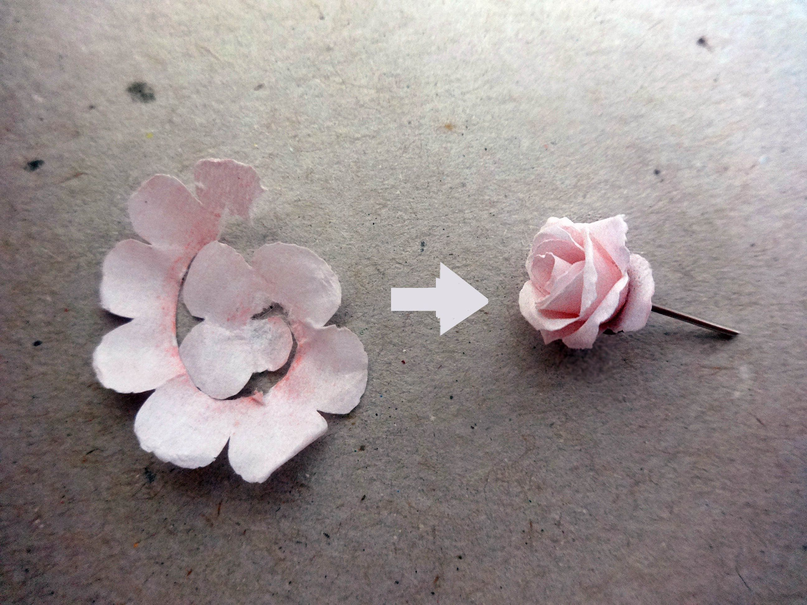 A DIY pair of rose earring made out of paper. The diameter ...