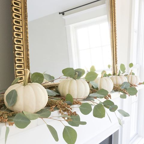 Mini white pumpkins, eucalyptus, and broom corn... What's on your fall mantle? Happy Friday! Pumpkins from @therestonfarmmarket. Eucalyptus from @traderjoes. Broom corn from a local florist. #fallmantledecor