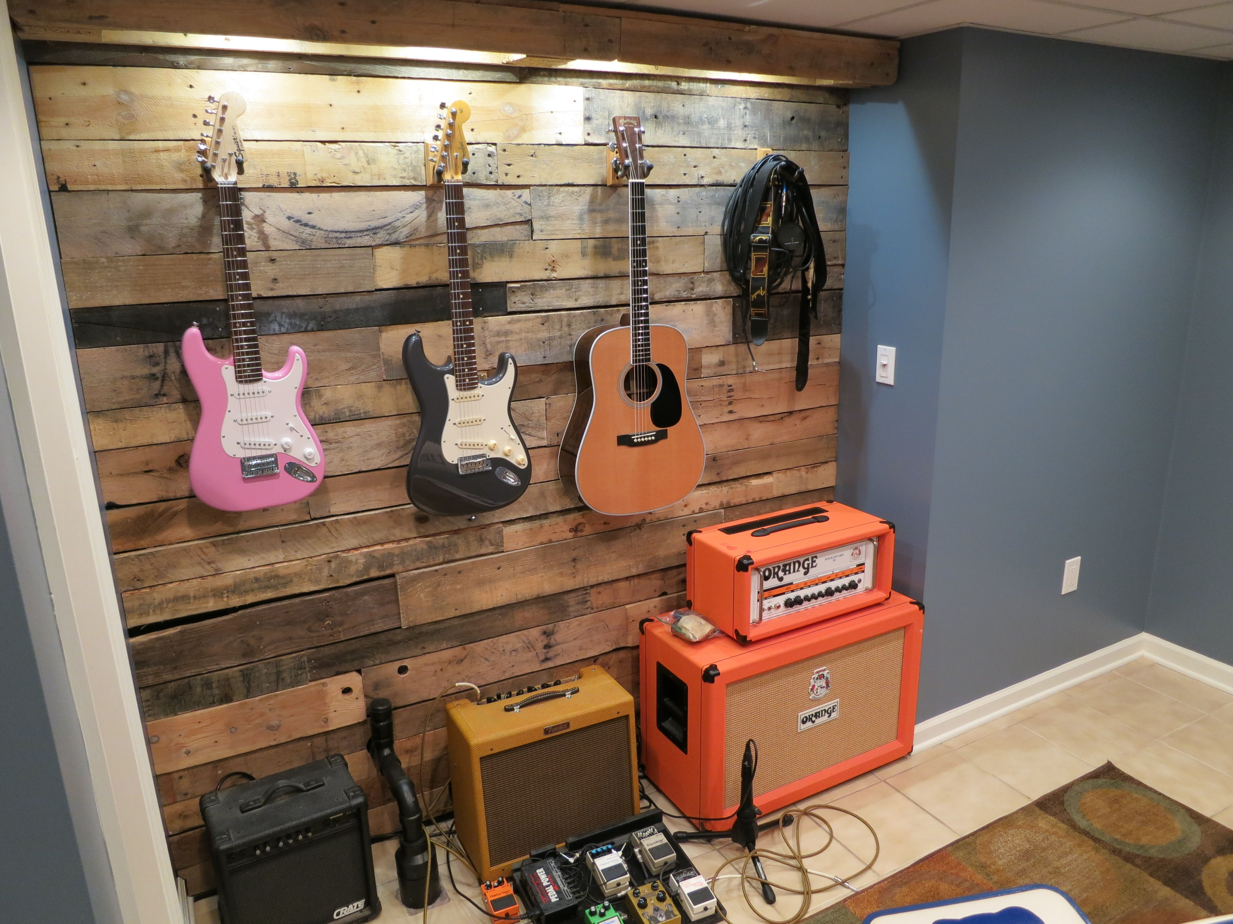 Recycled pallet wood to hang guitars and build light box string