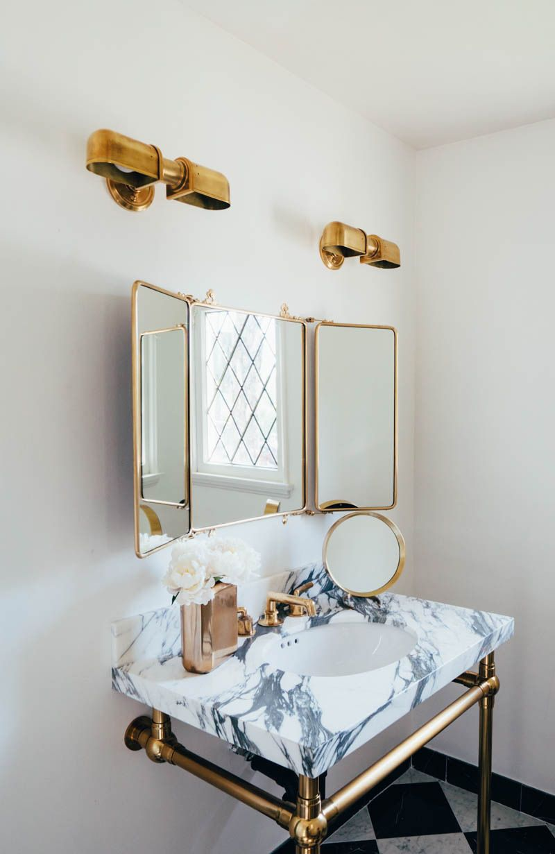 Website Photo Gallery Examples Aimee Song us bathroom is goals Love the gold hardware paired with the marble sink