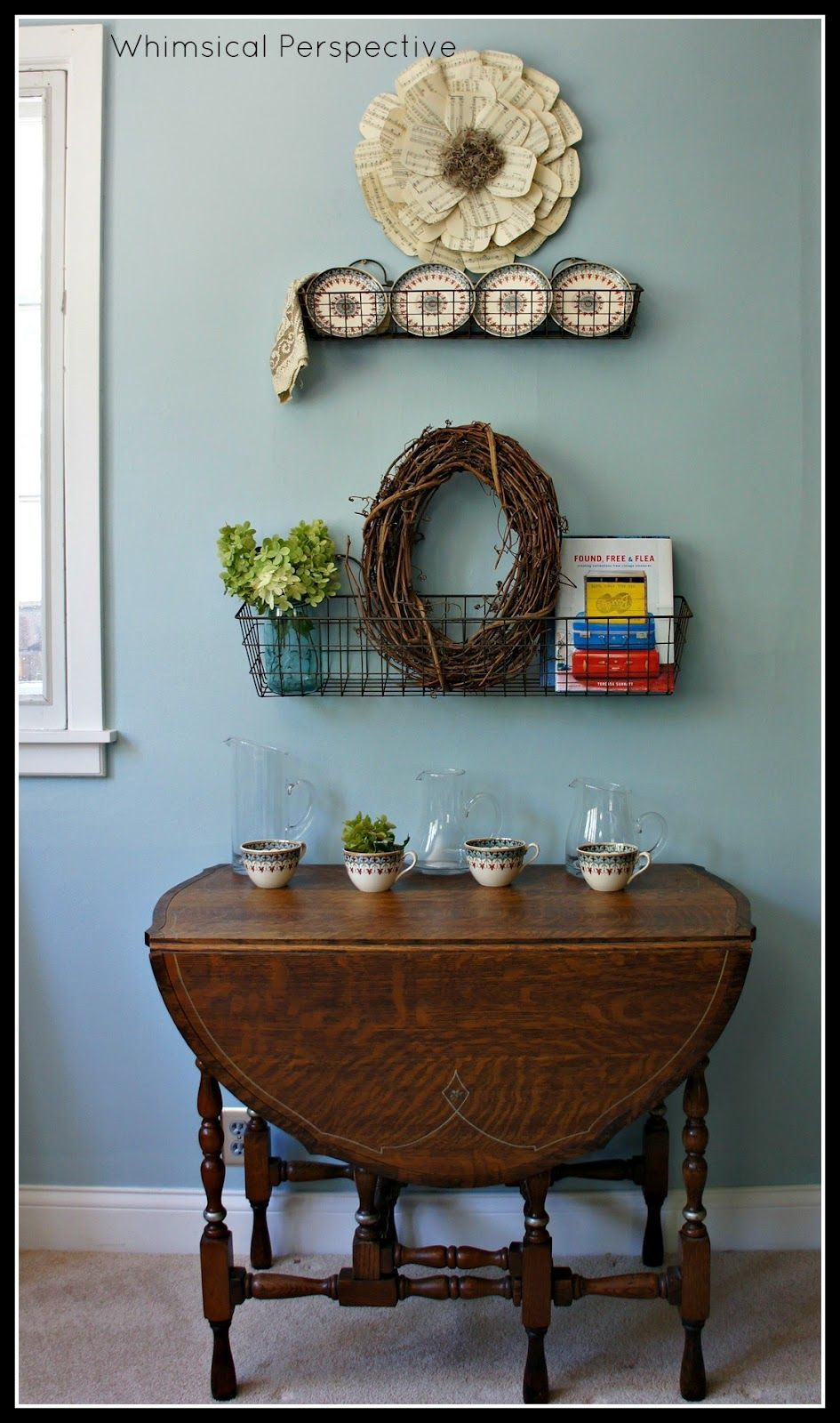 Whimsical Perspective.....love the wire basket hanging on the wall ...