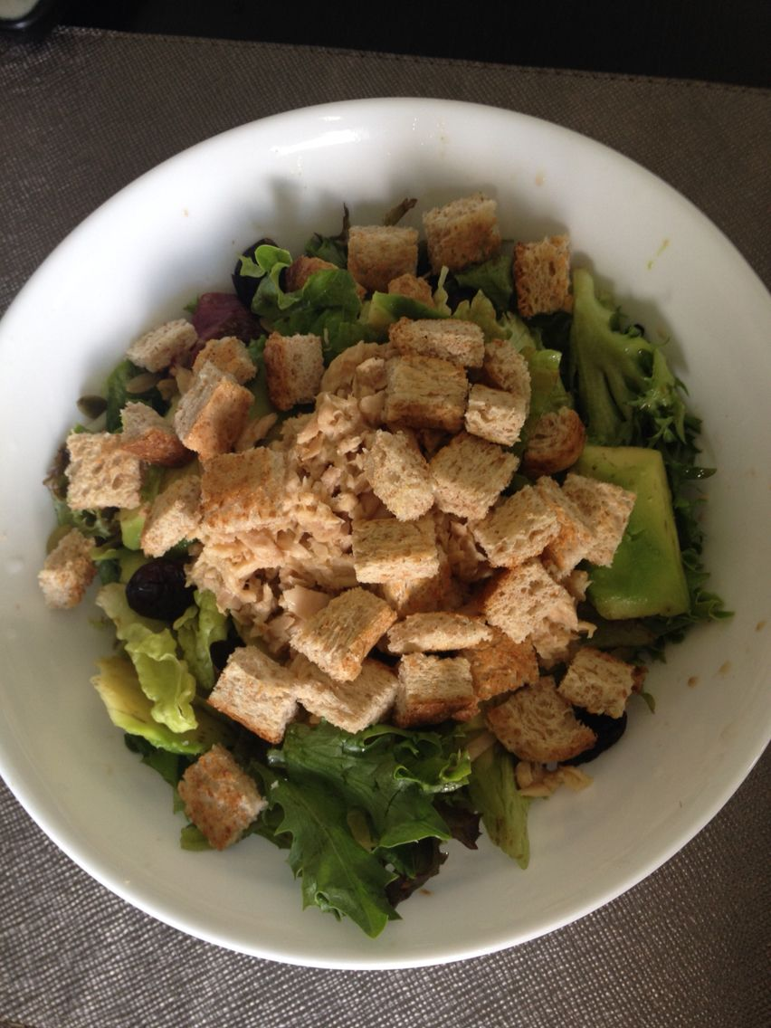 Tuna on a bed of salad with brown bread croutons