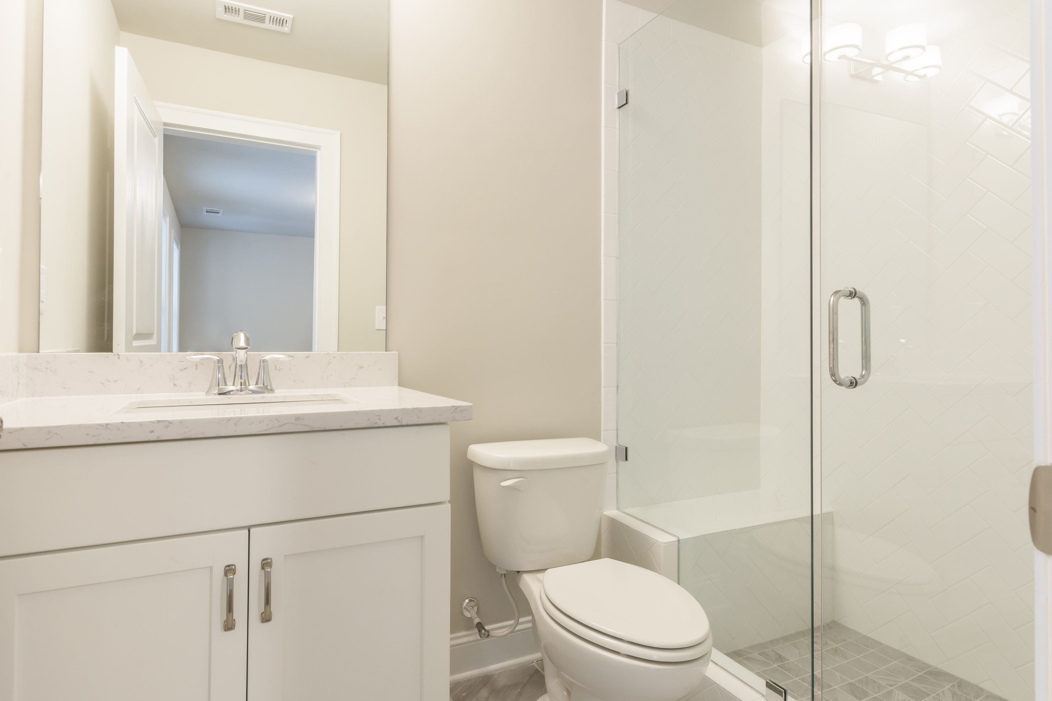 This Beautiful White Bathroom In Our Freemont Plan Features Wellborn Cabinets Glacier Piedrafina Carrera Marble Counters And Subway Tile