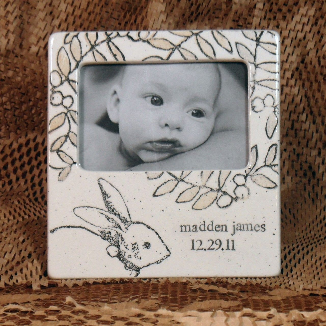 Museware Pottery - Baby Bunny Photo Frame, $80.00 (http://www.musewarepottery.com/baby-gifts/personalized-baby-bunny-photo-frame/)