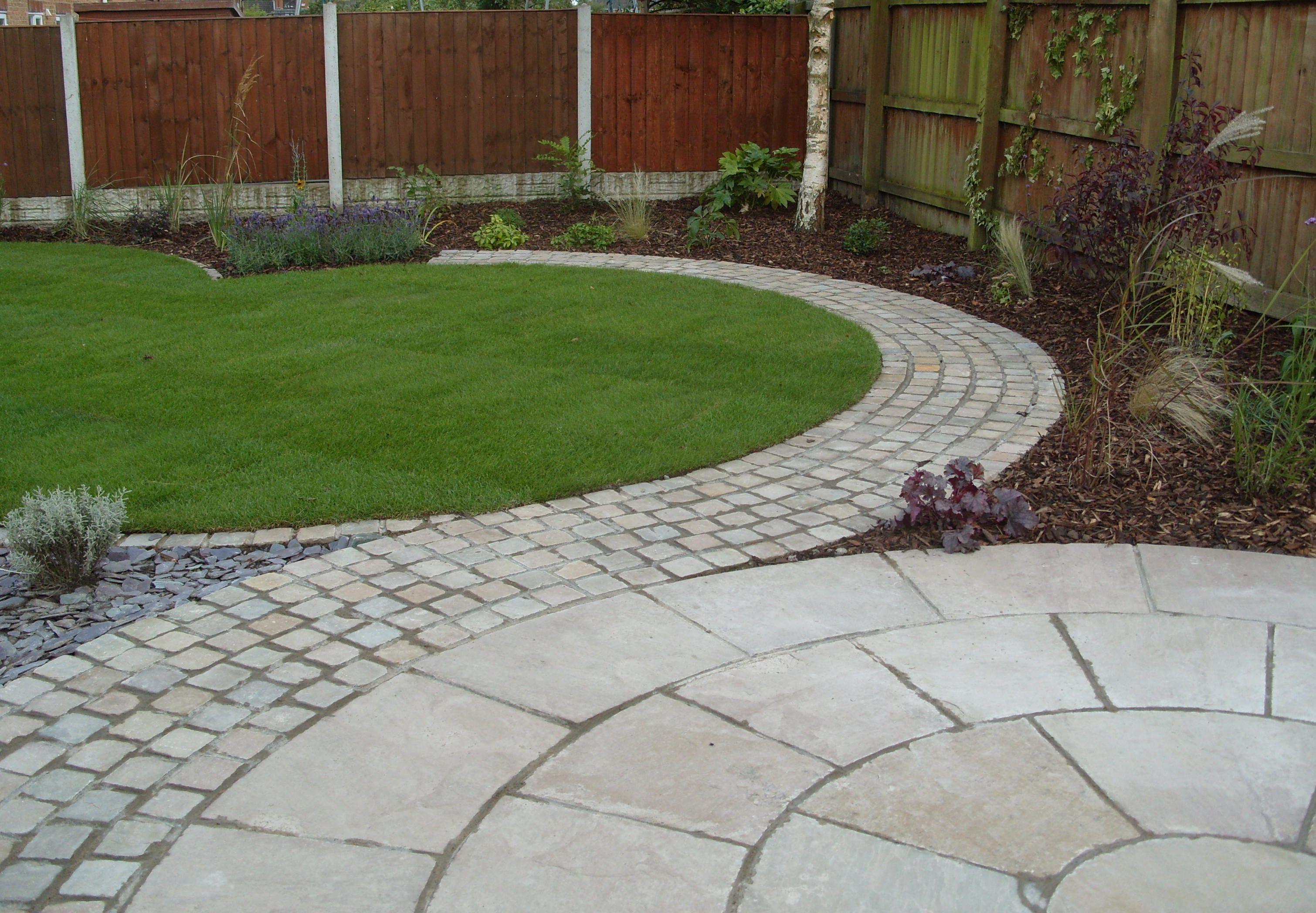 Garden Ideas Garden Design Patio With Wooden Pattern Fence And Round Concrete Tiles Paver Patio Garden Design Diy Patio Pavers
