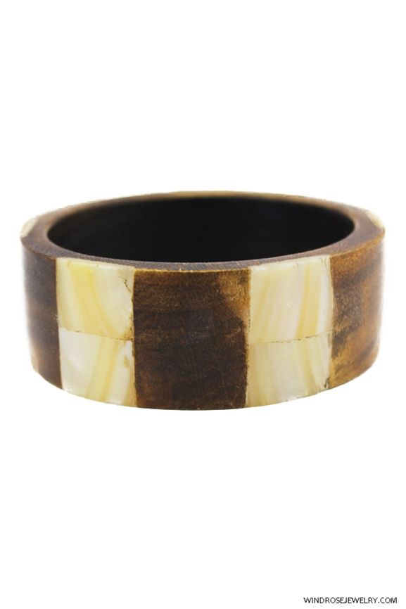 30a94881c81 Vintage carved chunky wood bangle with wide mother of pearl shell inlay.  $15 Shop this