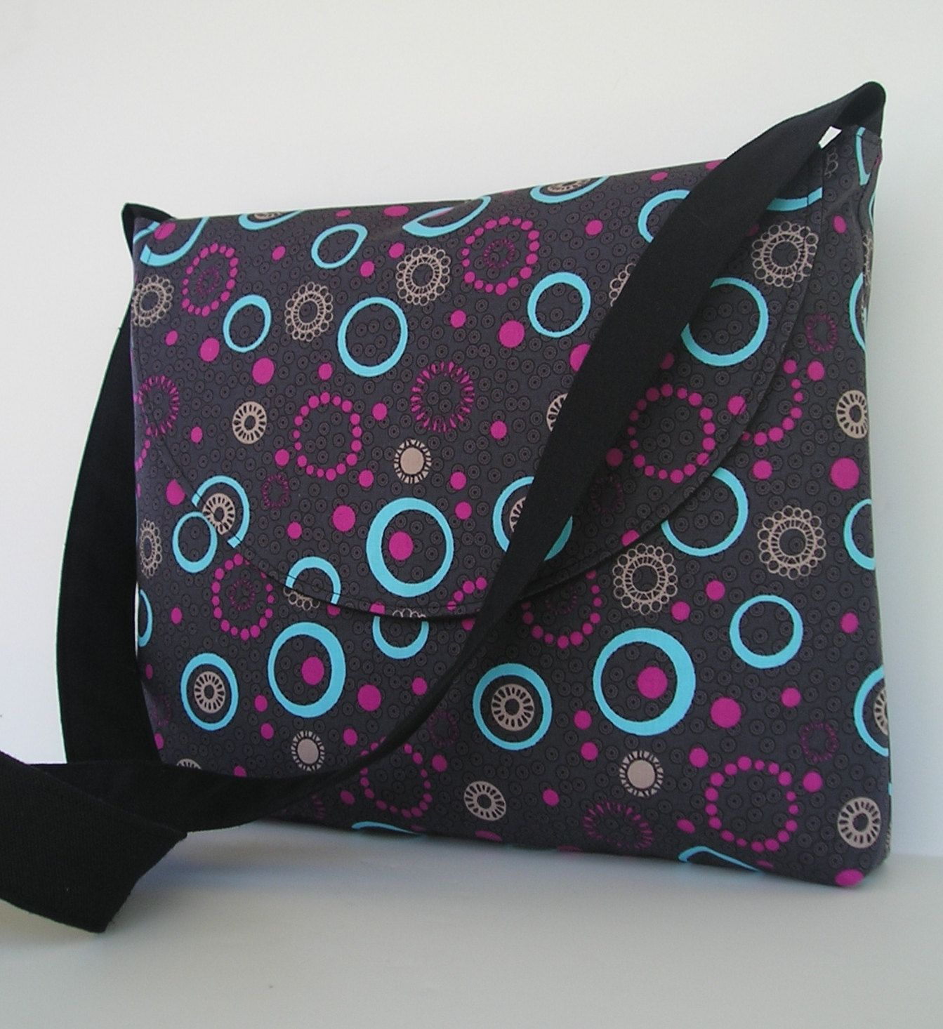 Messenger Bag / Crossbody Bag / iPad / Laptop / Diaper Bag in Circle Design. $30.00, via Etsy.