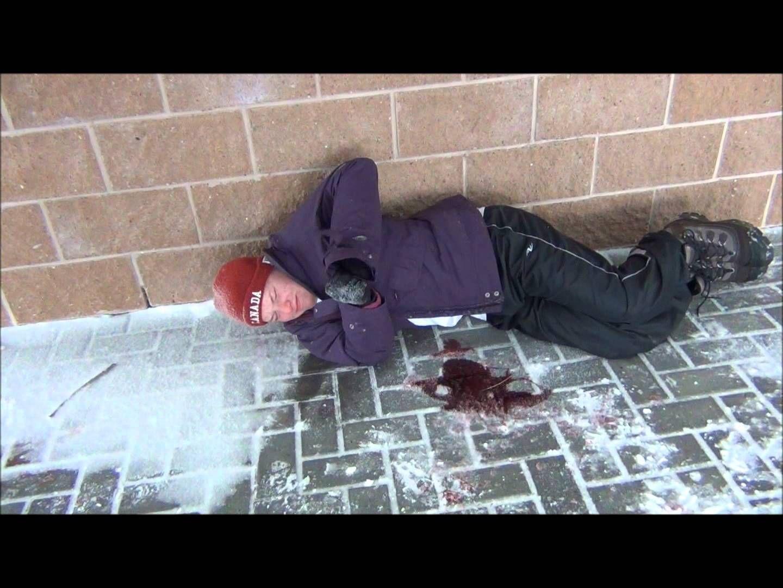 on the sidewalk bleeding